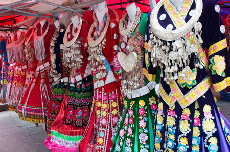 finery: Ethnic costumes selling in the market Stock Photo
