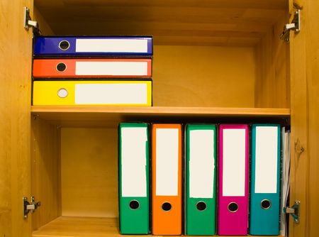 Colorful files with blank label in closet. photo