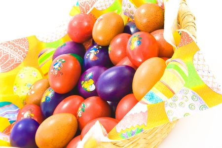 Basket full of colorful easter eggs. Isolated. photo