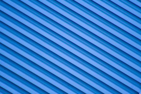 diagonal stripes: Blue diagonal stripes bacground from a building.