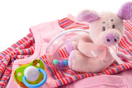 Clothes, toys and soother for a , isolated. Copy space.