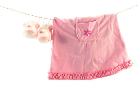 comfy: Little girls clothes and slippers hanging on a rope. Copy space