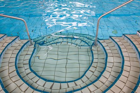 Picture of indoor swimming pool with interesting details. photo