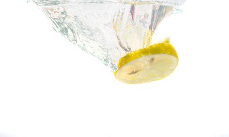 Splash of lemon slice in the water. Stock Photo - 3248578