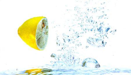 Splash of lemon slice in the water. Stock Photo - 3248586