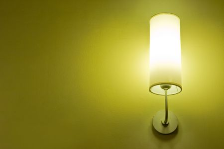 Lamp on a wall shining. Including copy space. Stock Photo - 3763418
