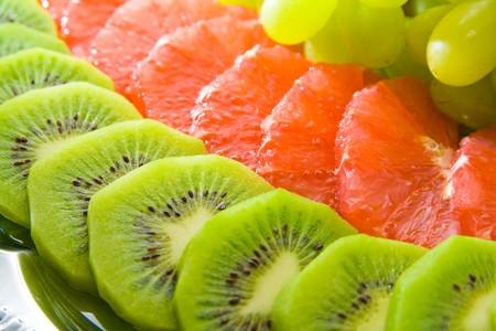Tasty fruit salad on tray. Multiple fruits. photo