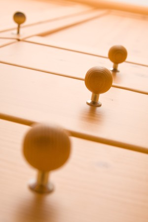 Modern wooden drawer handles. Shallow depth of field. Stock Photo - 4243247