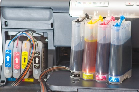 Continous ink supply system - CISS close up. Stock Photo - 4243257