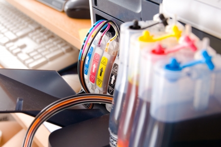 Continous ink supply system - CISS close up. Stock Photo