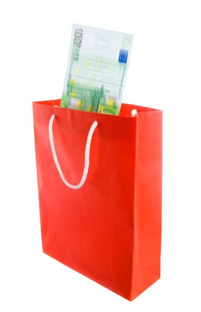 Concept of money falling in shopping bag. Blur on banknotes for motion.
