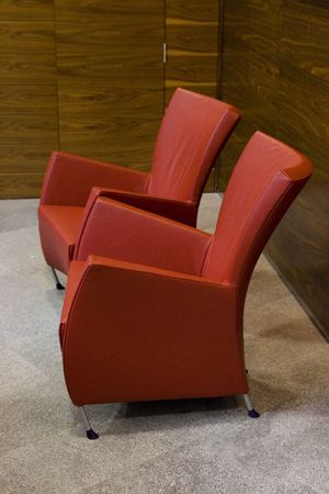 Empty modern red chairs in waiting room. Interior. Stock Photo - 4706828