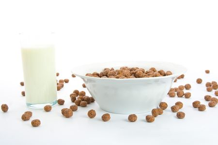 Chocolate balls with milk for breakfast in ceramic bowl. Isolated on white. Stock Photo - 4706814
