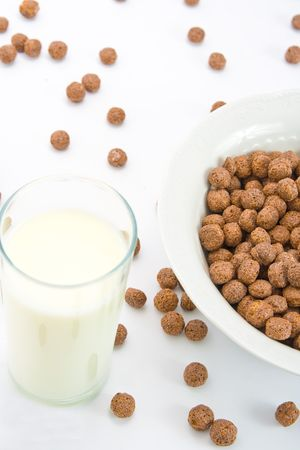 Chocolate balls with milk for breakfast in ceramic bowl. Isolated on white. Stock Photo - 4706815