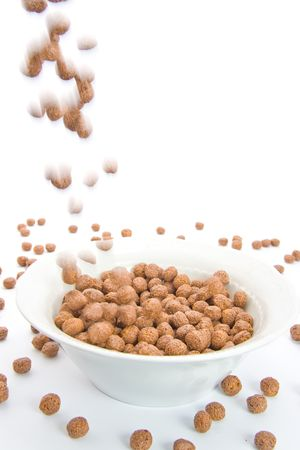 Chocolate balls falling in ceramic bowl-blur representing motion. Isolated on white. Stock Photo - 4706820