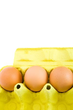Carton of few eggs in a cardboard box. Isolated on white background. photo