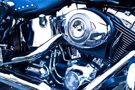 Side view of an engine of motorcycle, with blue tint. Stock Photo
