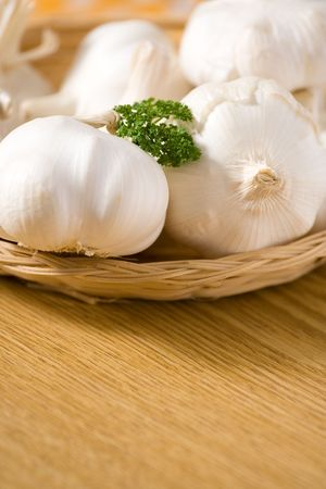 Garlic on a wooden table with decoration. Shallow dof. Stock Photo