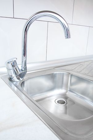 kitchen detail: Water tap and sink in a modern kitchen. Stock Photo