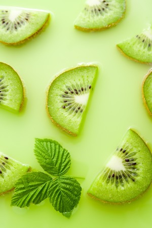 Fresh healthy sliced kiwi representing juice concept. photo