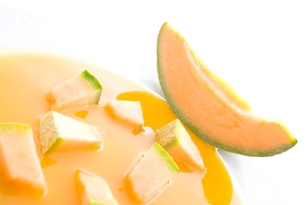 Sliced melons on plate representing soup concept. Stock Photo - 7280825