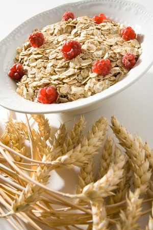 Bowl of wheat cereal with fresh raspberries. photo