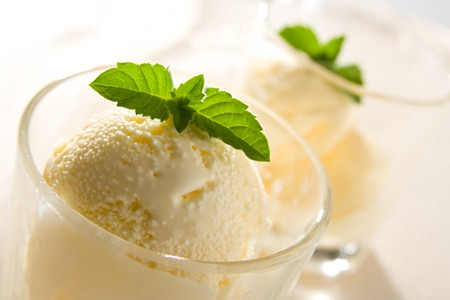 Delicious vanilla ice cream with mint leaves. Stock Photo
