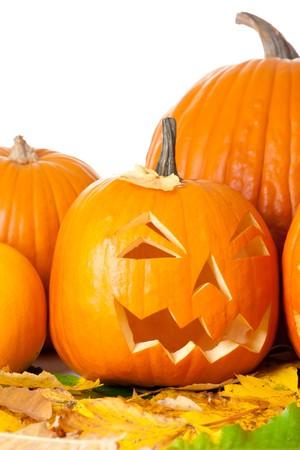 Carved Halloween Jack O Lantern with autumn foliage isolated on white background. Stock Photo - 7944820