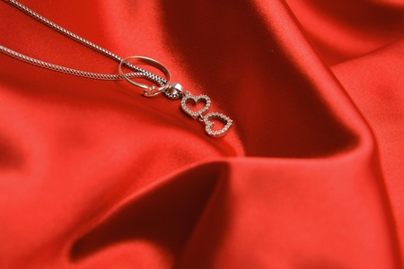 Valentines day necklace with two hearts pendant and a ring. photo