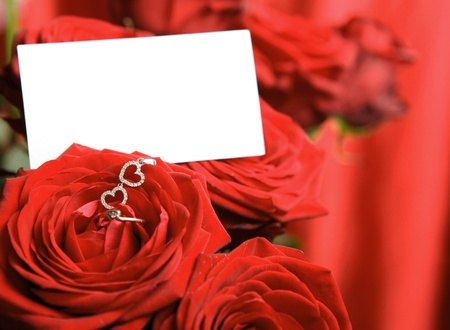Valentine's day two hearts pendant and a ring on red rose with copy space. Stock Photo - 8609587