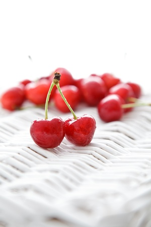 homegrown: Delicious home-grown cherries on white wooden texture.