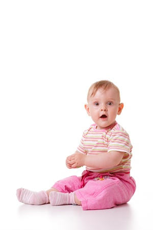 nine months: Cute nine months old caucasian baby girl isolated.