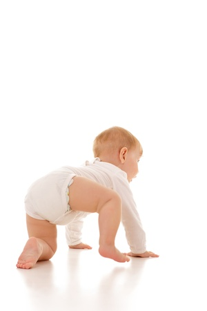 crawling baby: Cute eleven months old caucasian baby girl crawling, isolated.