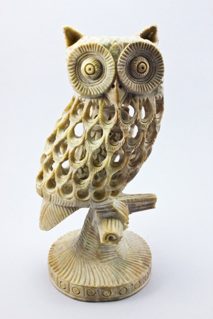 stone owl handcraft  on white background