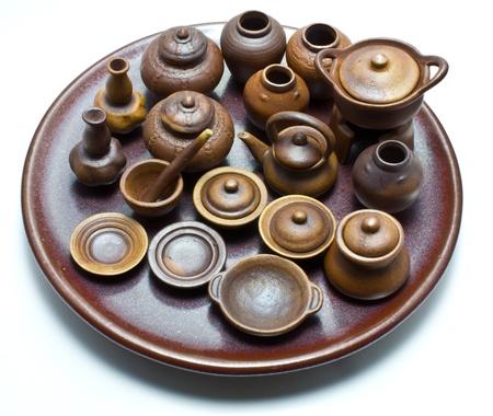 handmade mini clay pot on white background Stock Photo
