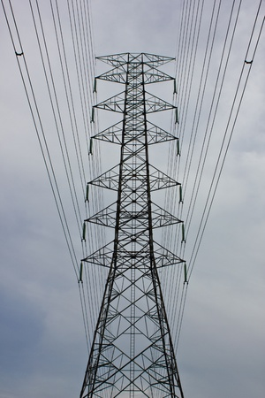 high voltage electric tower in cloudy day Stock Photo