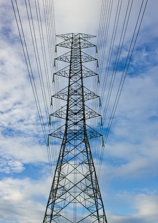 high voltage electric tower on sunny day
