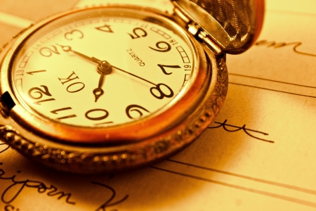 vintage watch on a book Stock Photo - 11810730