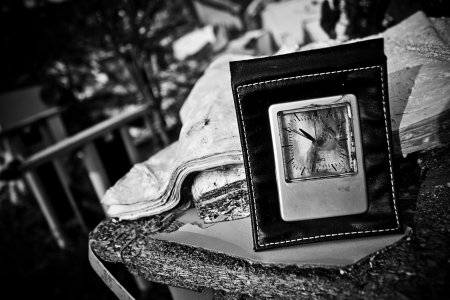old dirty clock on the old table Stock Photo