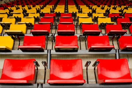 Red and yellow stadium seat photo