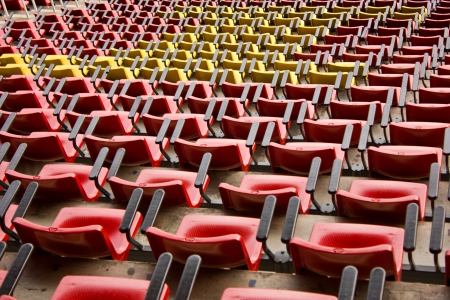Red and yellow stadium seat Stock Photo
