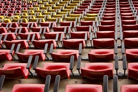 Red and yellow stadium seat Stock Photo