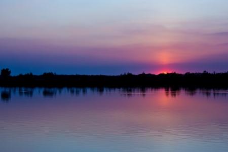 Sun fall down into the river when twilight