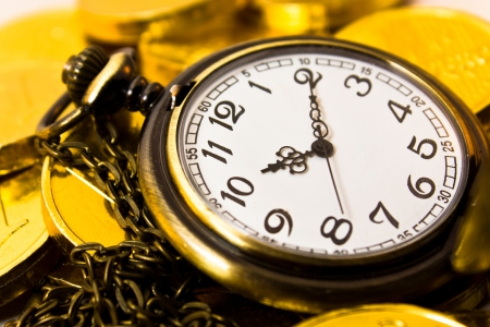 vintage chain watch on gold coin