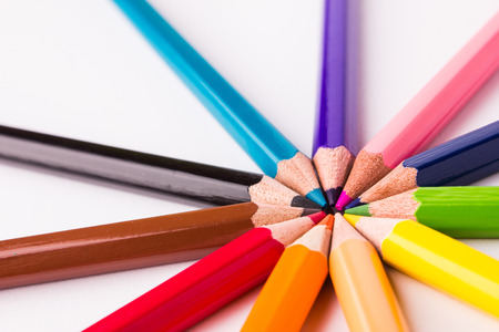 Many different colored pencils on white background