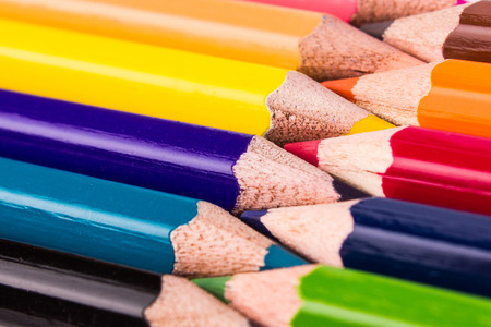 Many different colored pencils join together