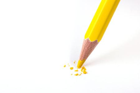 close up of yellow color pencil head break