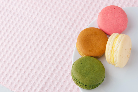 Tasty colorful macaroon on a plate