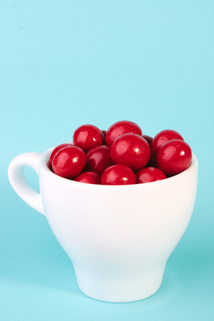 red candy chocolate ball in a cup Stock Photo