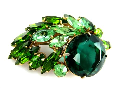 emerald stone: isolated  emerald brooch  Stock Photo